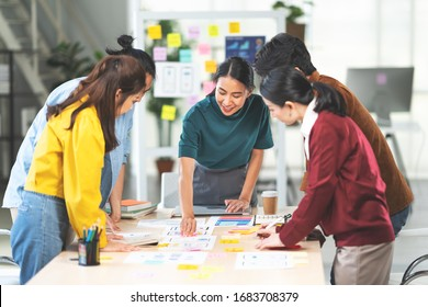 Young Asian woman leading business creative team in mobile application software design project. Brainstorm meeting, work together, internet technology, girl power, office coworker teamwork concept
