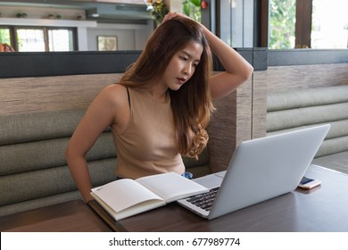 Young asian woman lokking data on laptop, Business concept