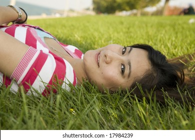 Young Asian Woman lying on the grass