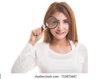 Young Asian woman with a magnifying glass  isolated on white background