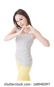 Young asian woman make heart shape on her belly. Isolated on the white background.