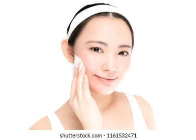 Young asian woman making up. Skin care convept.