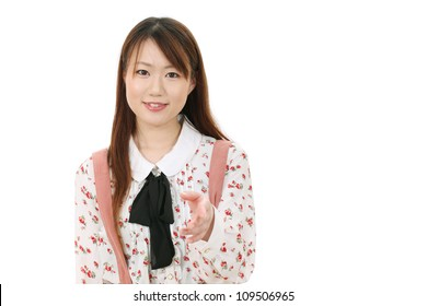 Young asian woman offering handshake over white background