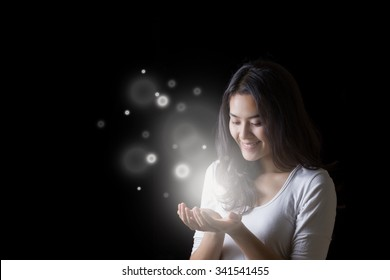 Young Asian woman opening hands with smiley face at night.