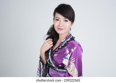 Young asian woman in oriental purple dress.