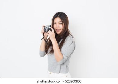 Young Asian woman photographer