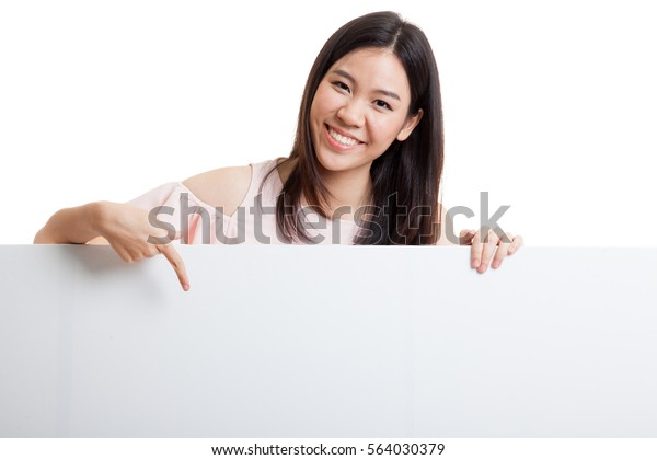 Young Asian woman point to a  blank sign  isolated on white background.