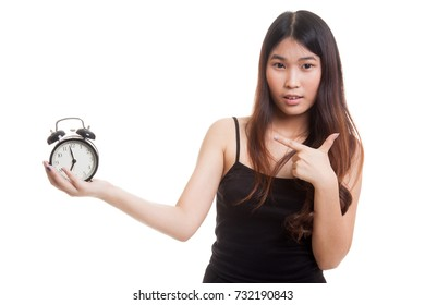 Young Asian woman point to a clock isolated on white background