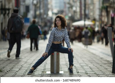 Young asian woman posing on the St.Catarina street in the center of Porto, Portugal.