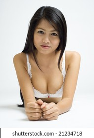 young asian woman posing in white lingerie