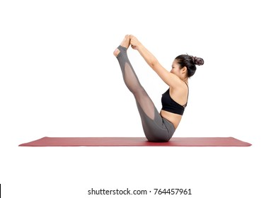 young asian woman practicing yoga in Navasana or Boat yoga pose on the mat isolated on white background, exercise fitness, sport training and healthy lifestyle concept