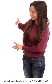 Young asian woman presenting your product on a white card