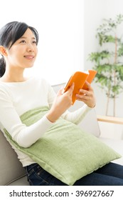 young asian woman reading a book