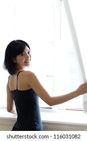 a young asian woman relaxing in the morning