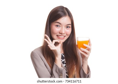 Young Asian woman show OK drink orange juice isolated on white background