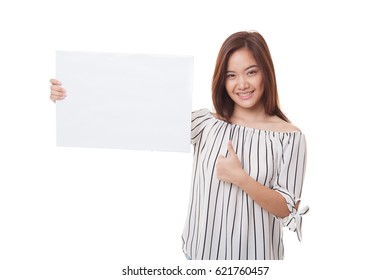 Young Asian woman show thumbs up with  white blank sign isolated on white background