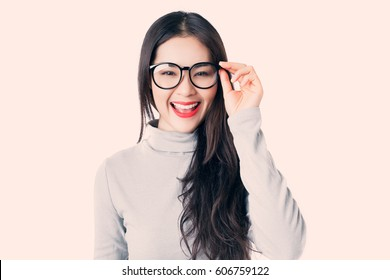 Young Asian woman with smiley face wearing glasses,vintage style.