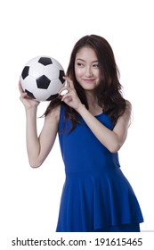 Young Asian woman with soccer ball over white background