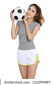 young asian woman in sport wear holding football  on her hand