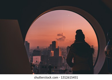 Young asian woman standing look city view with sunset sky Twilight  of Osaka city Japan,vintage tone,Travel concept background.
