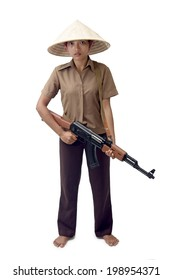A young Asian woman standing with a machine gun on white background. Armed girl holding a Kalashnikov sub-machine gun.