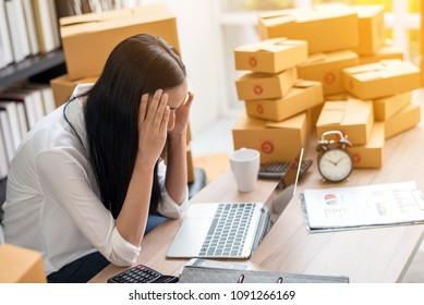 Young Asian woman stress with her business online shopping at office.