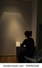 Young Asian woman is suffering alone from a severe depression- long exposure technique