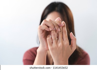 Young asian woman suffering from pain in fingertips. Female massaging painful hand from symptoms of Peripheral Neuropathy. Pain and numbness in fingertips and palms. Health care and physical concept.