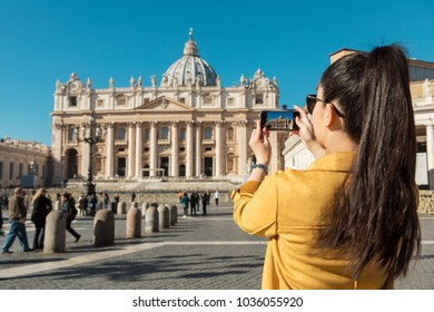Young Asian woman taking a picture on St. Peter's Square