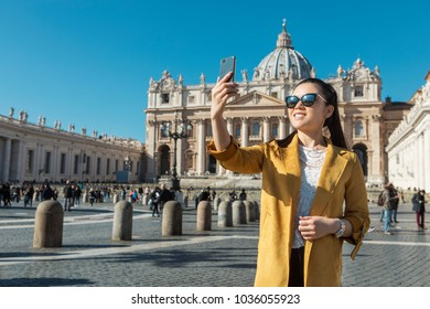 Young Asian woman taking a selfie on St. Peter's Square