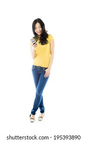Young Asian woman text messaging on a mobile phone