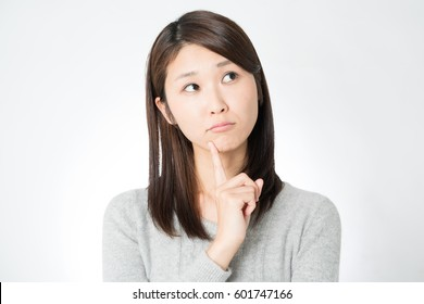 Young Asian woman thinking.