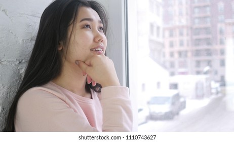Young Asian Woman Thinking and Brainstorming, Sitting at Window