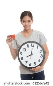 Young Asian woman with tomato juice and clock  isolated on white background.