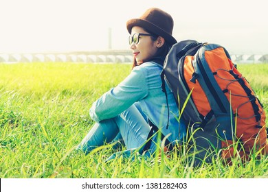 Young asian woman traveler with backpack and hat. Travel concept.