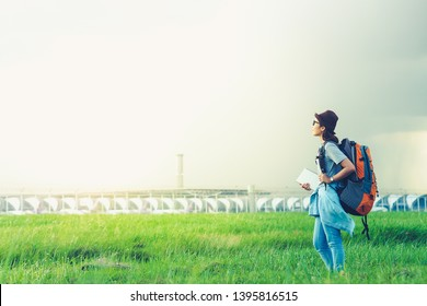 Young asian woman traveler with backpack and hat, travel, freedom and active lifestyle concept.