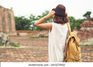 Young asian woman traveler with backpack traveling in Ayutthaya, Thailand. Travel concept.