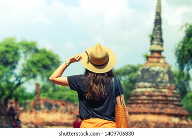 Young asian woman traveler traveling in Ayutthaya, Thailand. Travel concept.