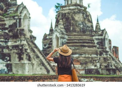 Young asian woman traveler traveling at Wat Phra Si Sanphet in Ayutthaya ,Thailand. Travel concept.