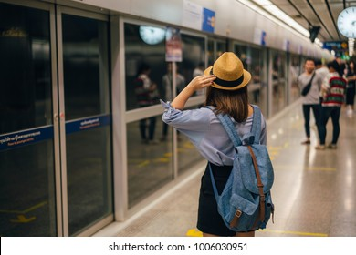Young asian woman traveler waiting for transportation underground in Bangkok subway MRT in Thailand