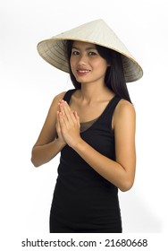 young asian woman with typical welcome expression