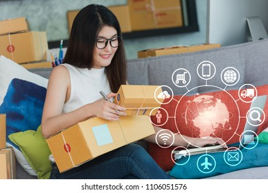 Young asian woman use smartphone and laptop run own business at home, internet of things conceptual, young entrepreneur with technology