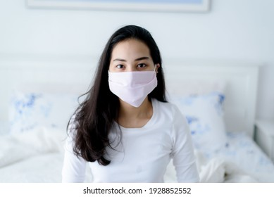 Young Asian woman wear a face mask to protect from covid virus outbreak.