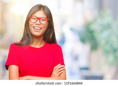 Young asian woman wearing glasses over isolated background happy face smiling with crossed arms looking at the camera. Positive person.