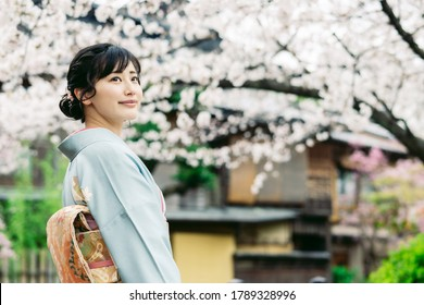 Young asian woman wearing kimono. Japanese traditional clothes.
