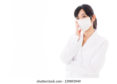 young asian woman wearing white coat thinking on white background