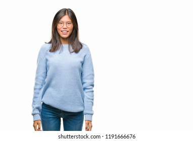 Young asian woman wearing winter sweater over isolated background with a happy and cool smile on face. Lucky person.