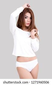 young asian woman in white shirt and bikini