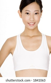 A young asian woman in white sports fitness bra on white background