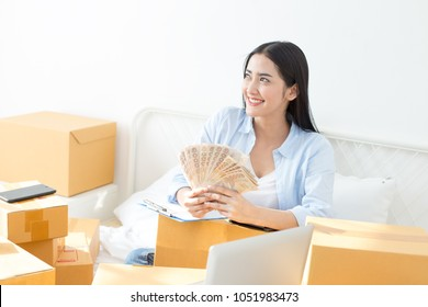 Young Asian Woman Working at home, Young Owner Woman Start up for Business Online. People with online shopping SME entrepreneur or freelance working concept.